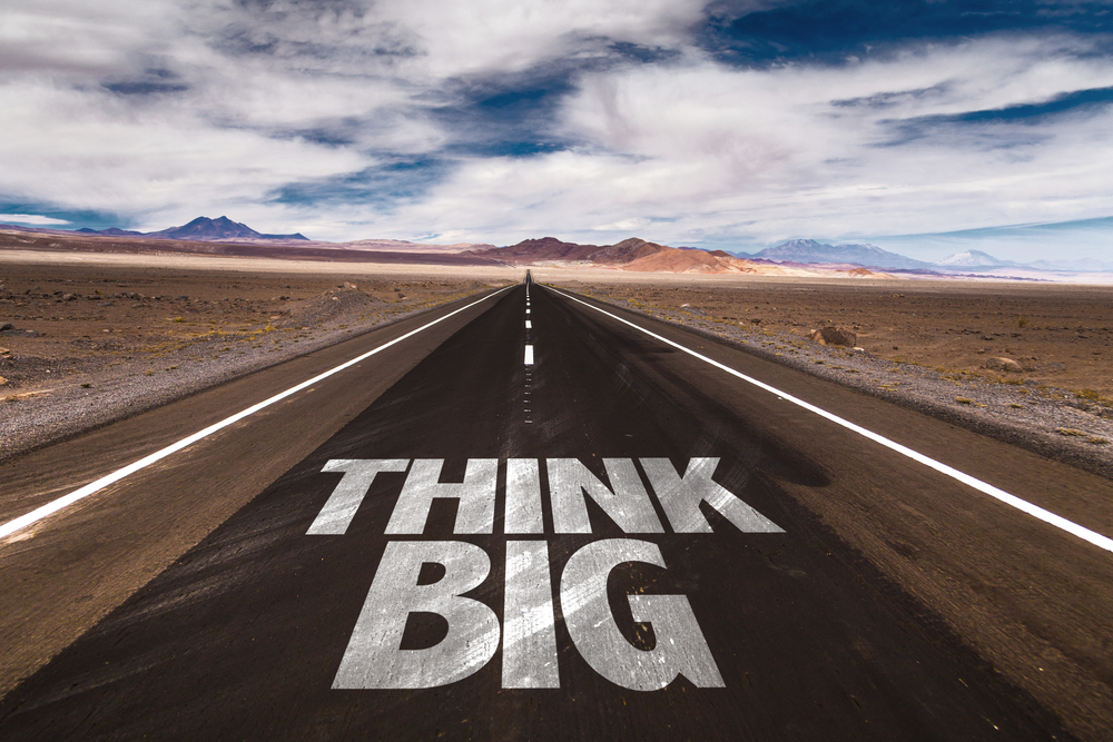 Think Big written on desert road